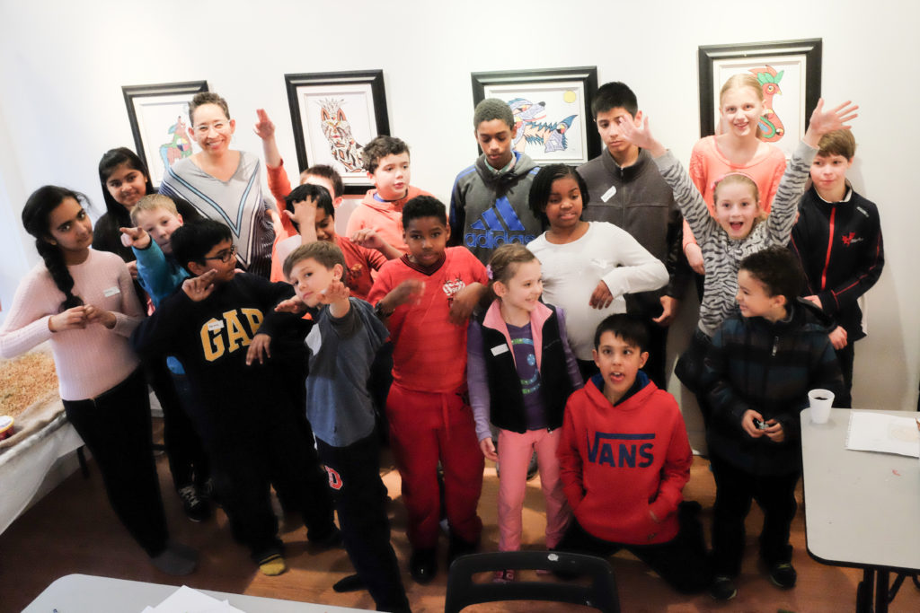 Group of participants from our After School Art Class with instructor. They are celebrating completing a project.