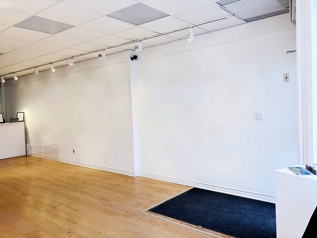Empty Arts Etobicoke Gallery facing the eastern blank white wall