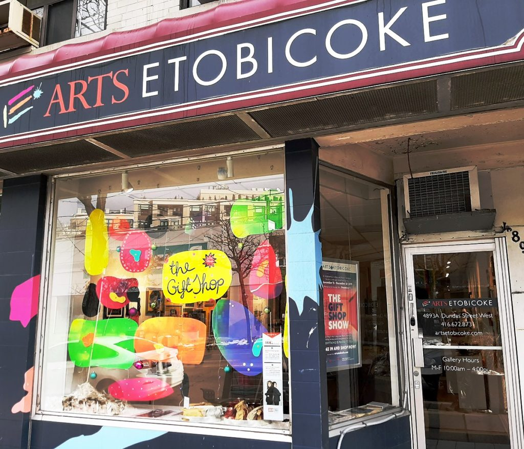 Front of Arts Etobicoke's Storefront Gallery with brightly coloured artist window installation